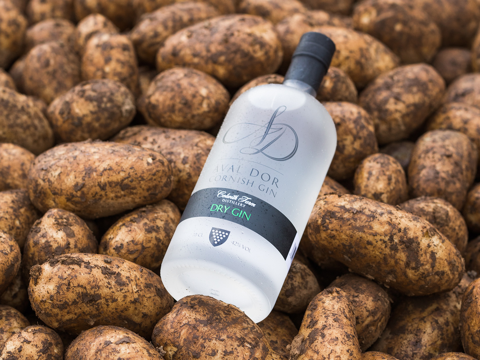 A bottle of Aval Dor Gin on a pile of potatoes