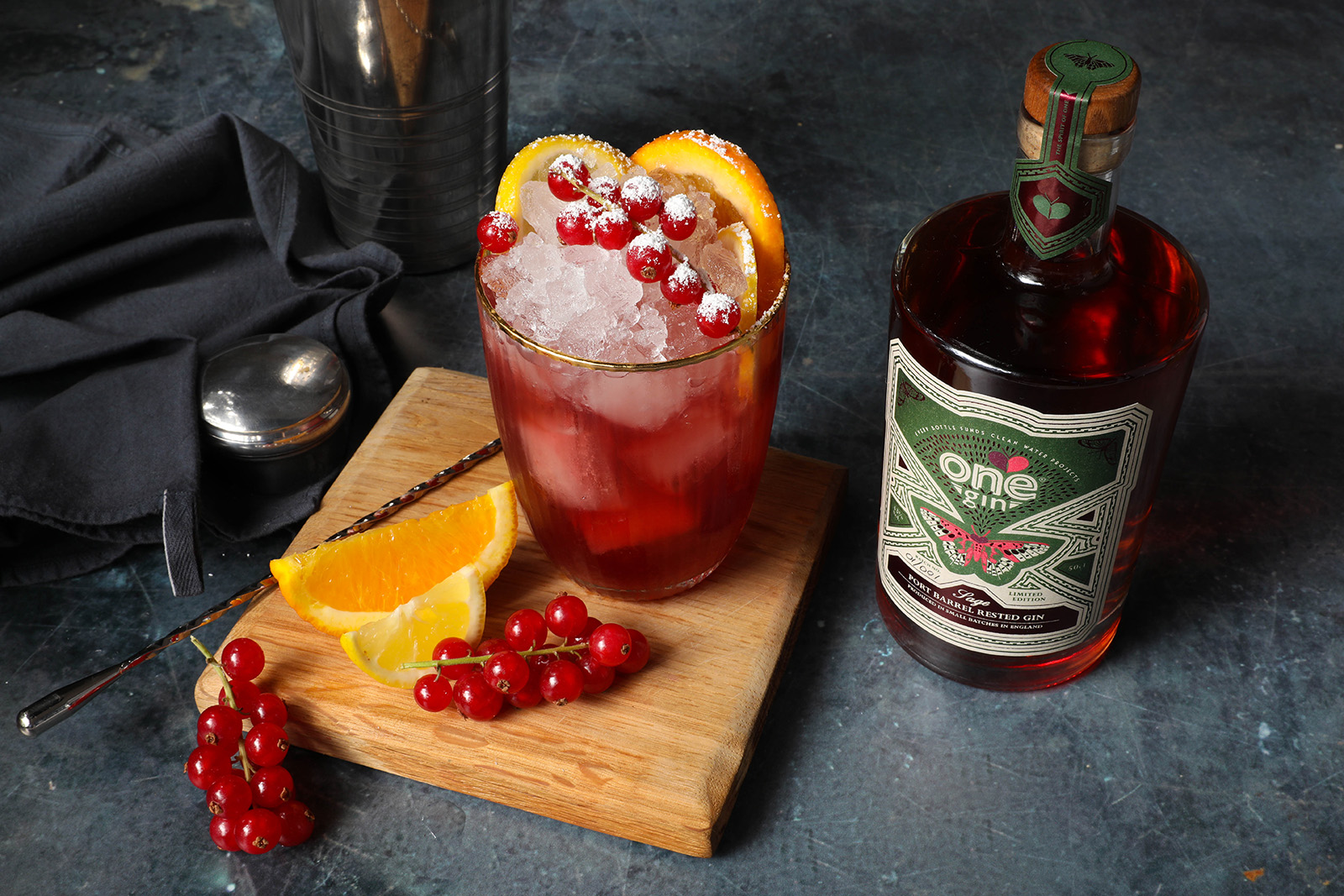 A Port Cobbler Cocktail served with redcurrant and orange segments