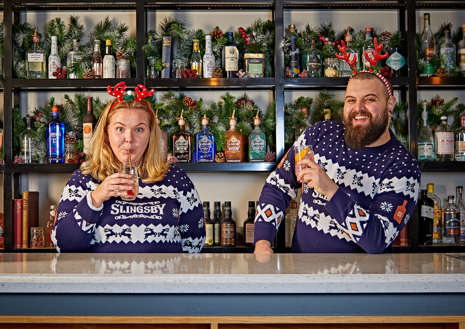 Slingsby Gin mixologists relax in Christmas jumpers with a gin and tonic