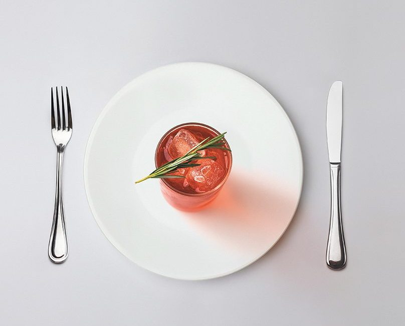 Serving up a gin cocktail on a plate